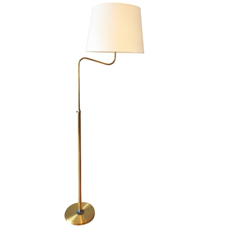 Tall Brass Swing Armed Adjustable Floor Lamp in the Manner