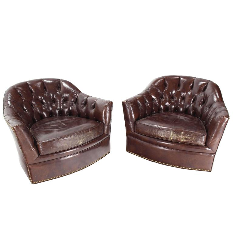 brown swivel chair outdoor recliner lounge pair of shiny leather chairs tufted chesterfield backs nice wear for sale