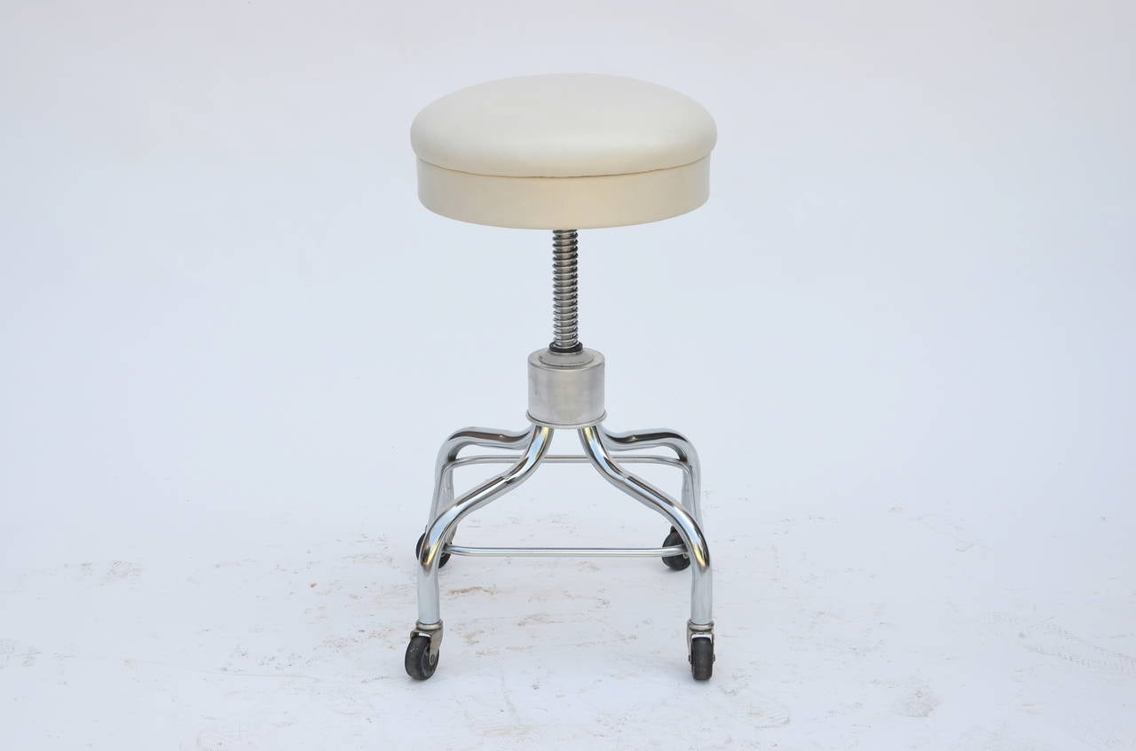 white rolling chair refurbished kitchen table and chairs set of four vintage chrome leather adjustable