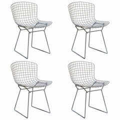 bertoia wire chair original teardrop swing set of four harry for knoll black side chairs by