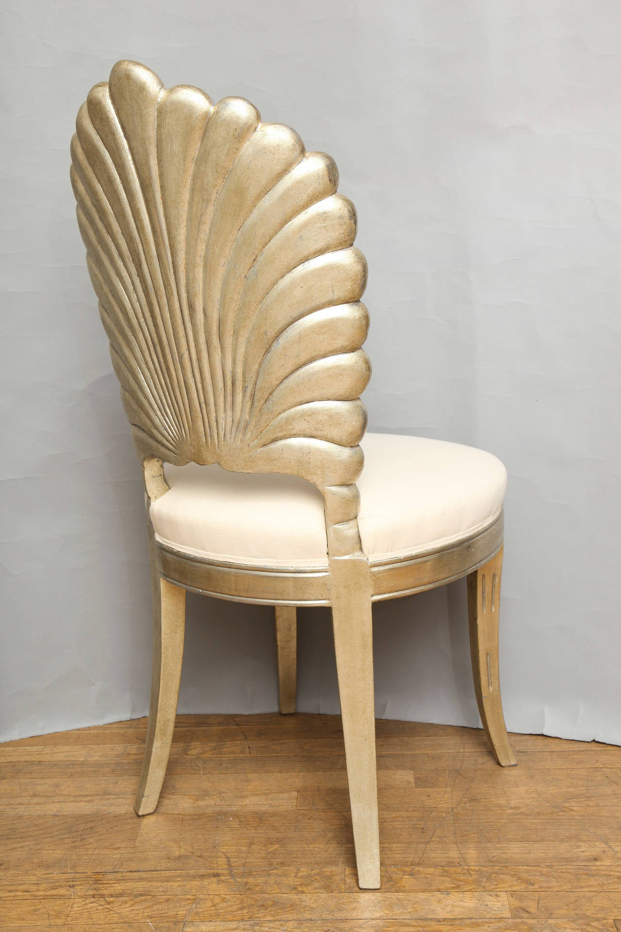 white shell chair seat lift an italian back carved and silver leafed for