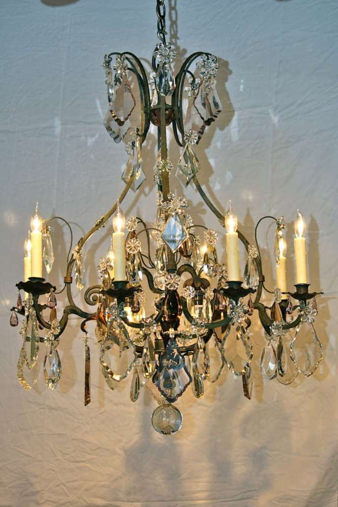 An Impressive French Wrought Iron And Tole Leaf Chandelier In Cage Form With Central Spear
