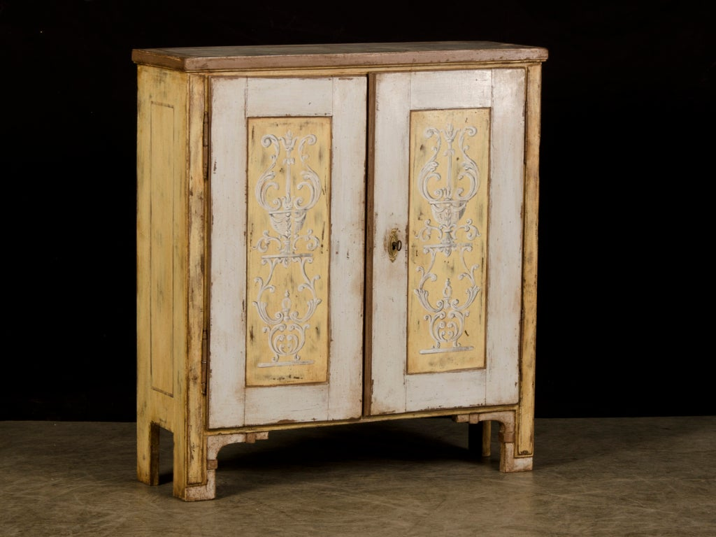 A shallow two door low painted cabinet from Germany c1825