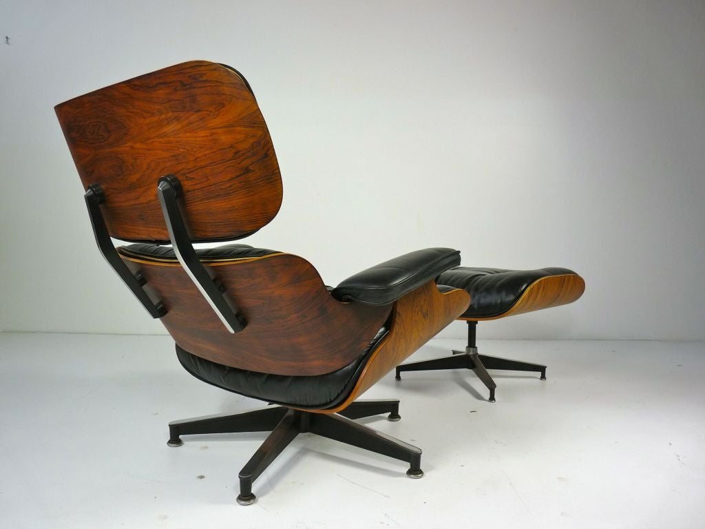 eames style lounge chair and ottoman rosewood black leather or stool say crossword at 1stdibs