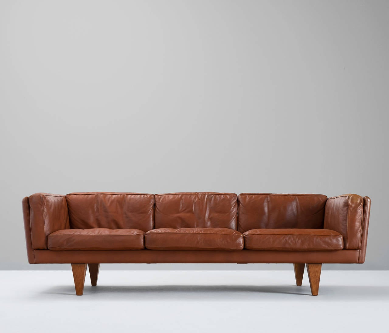 down filled leather sectional sofa piper grey illum wikkelsø three seat in brown and
