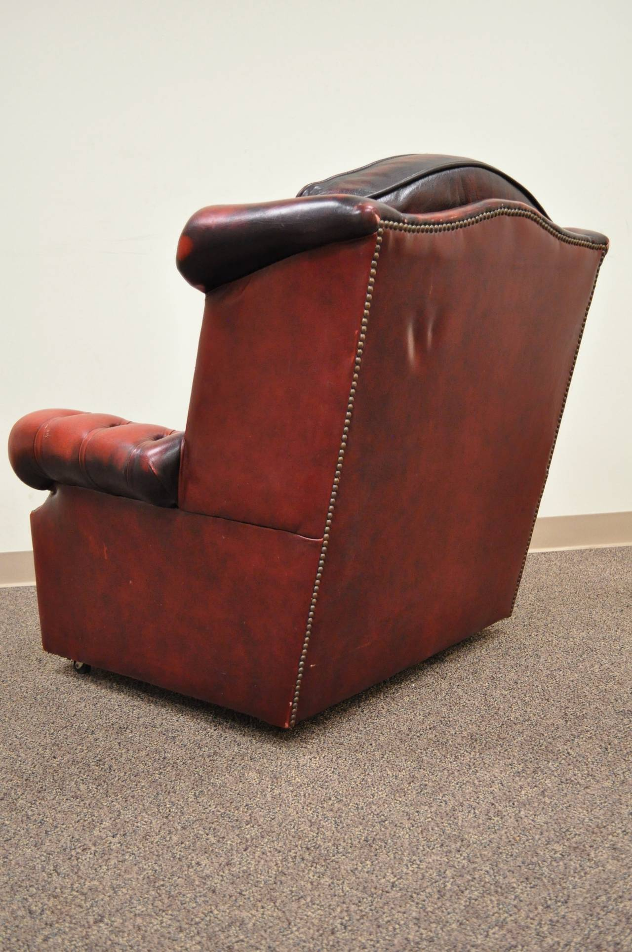 tufted leather sofa with rolled arms sleeper sectional striking arm chesterfield style lounge chair