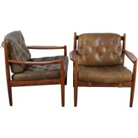 Pair of Mid Century Modern tufted leather chairs. at 1stdibs