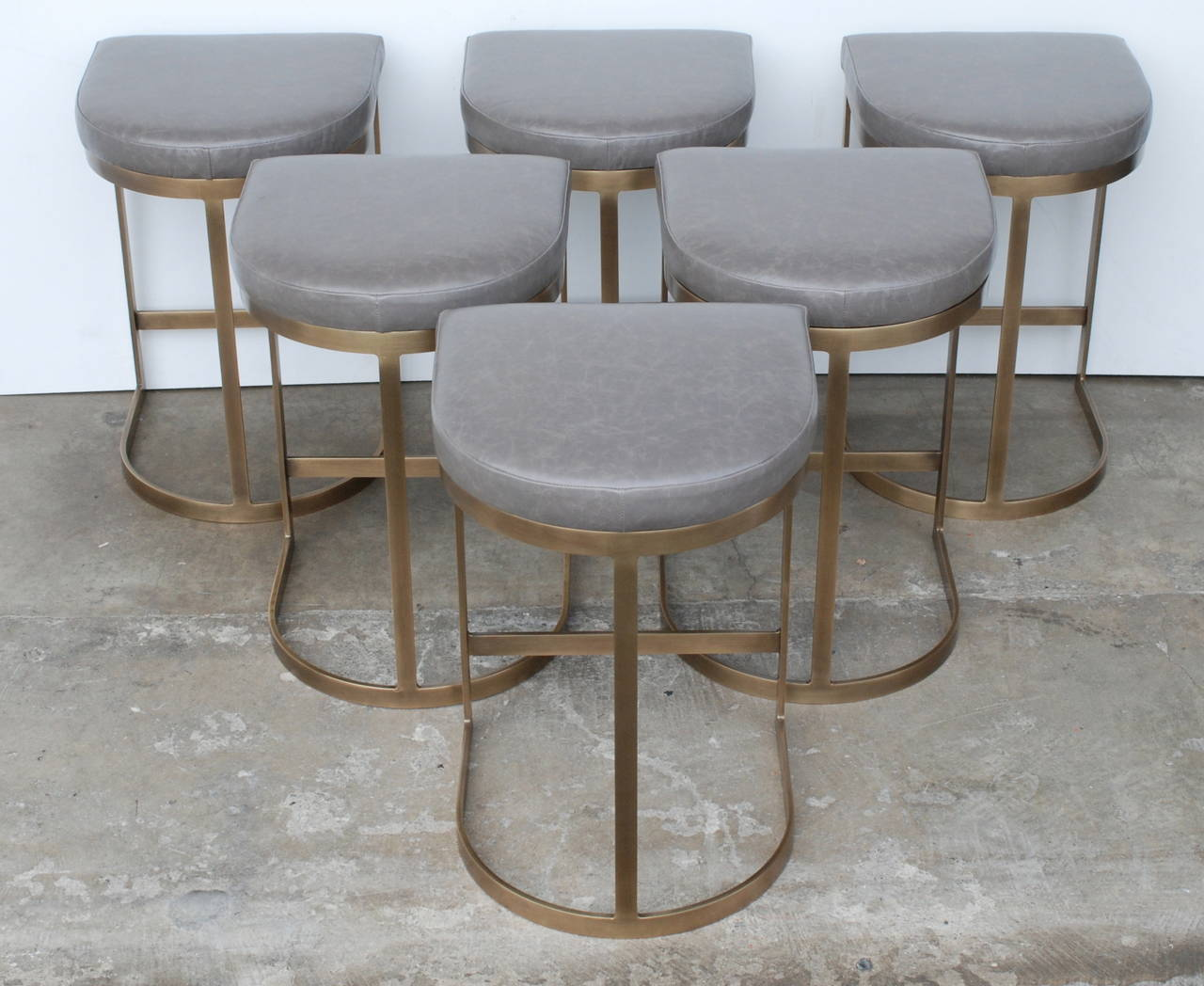 bar chairs concrete chair desk with storage bin uk milo baughman burnished brass stools in grey leather