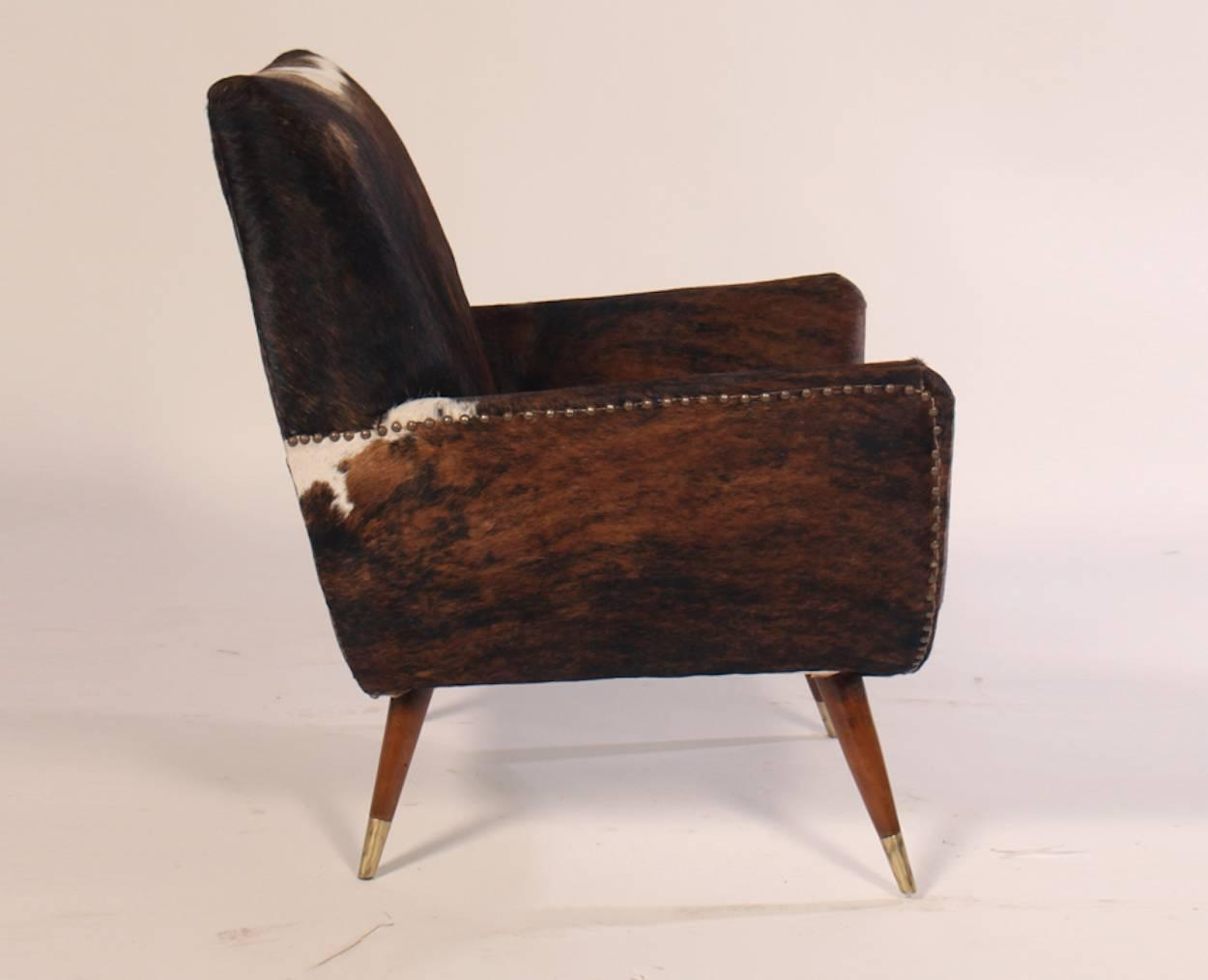 cowhide chairs modern oak table and italian mid century club covered in