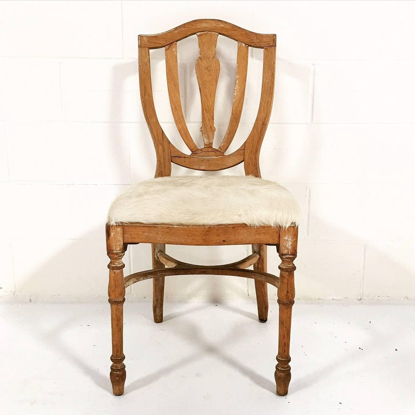 cowhide chairs nz wedding chair covers pictures vintage maple dining in brazilian ivory