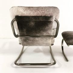 Cowhide Chairs Nz Giant Chair For Sale Design Institute Of America Rocker And Ottoman In