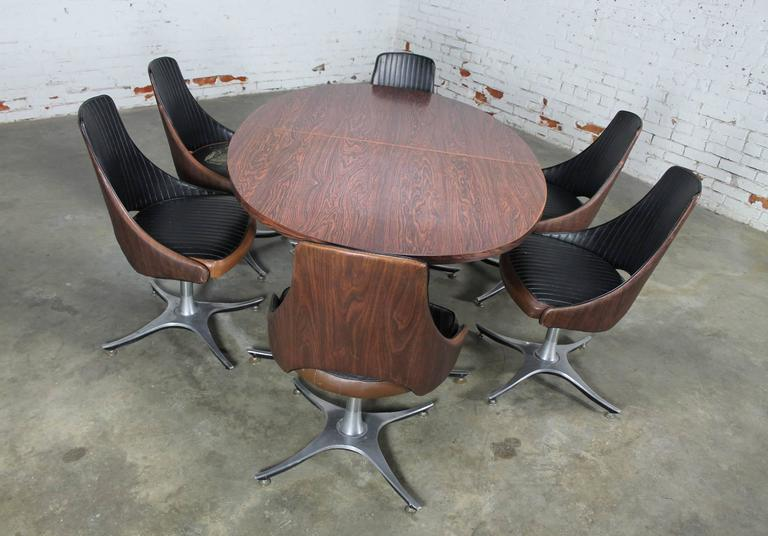 table with swivel chairs abode fishing chair review mid century dinette set oval double pedestal six fun and funky modern featuring an
