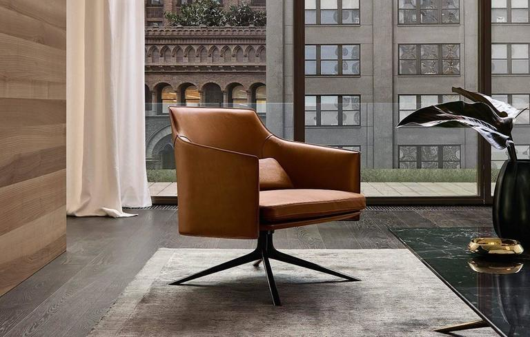 three cushion sofa table in front of poliform stanford low back armchair by jean-marie massaud ...