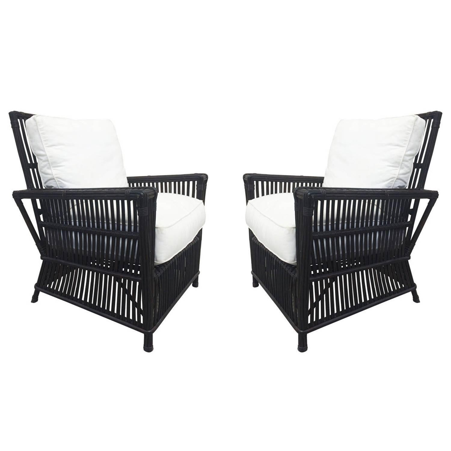 wicker or bamboo patio chairs and ottomans upholstered in white canvas