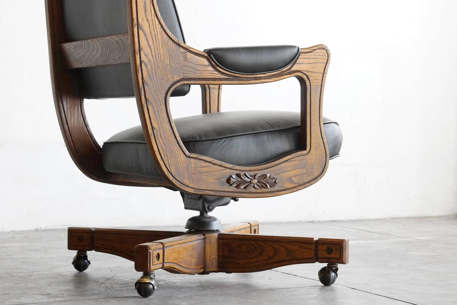 captains chair steelcase amia canada antique chesterfield in oak and leather at