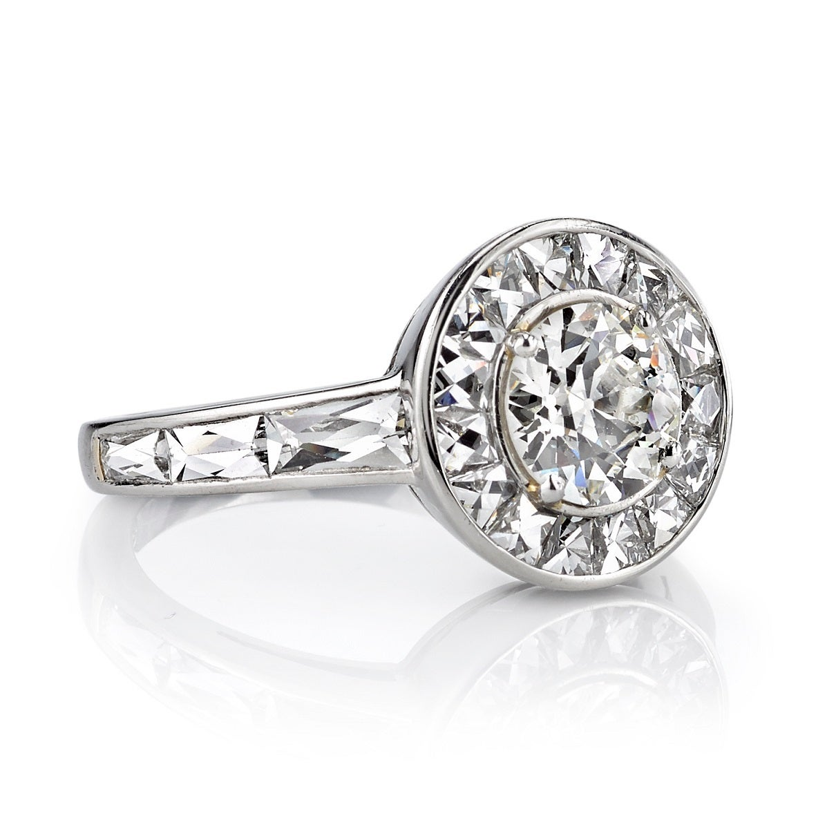 Round Diamond Surrounded By French Cut Diamonds Engagement