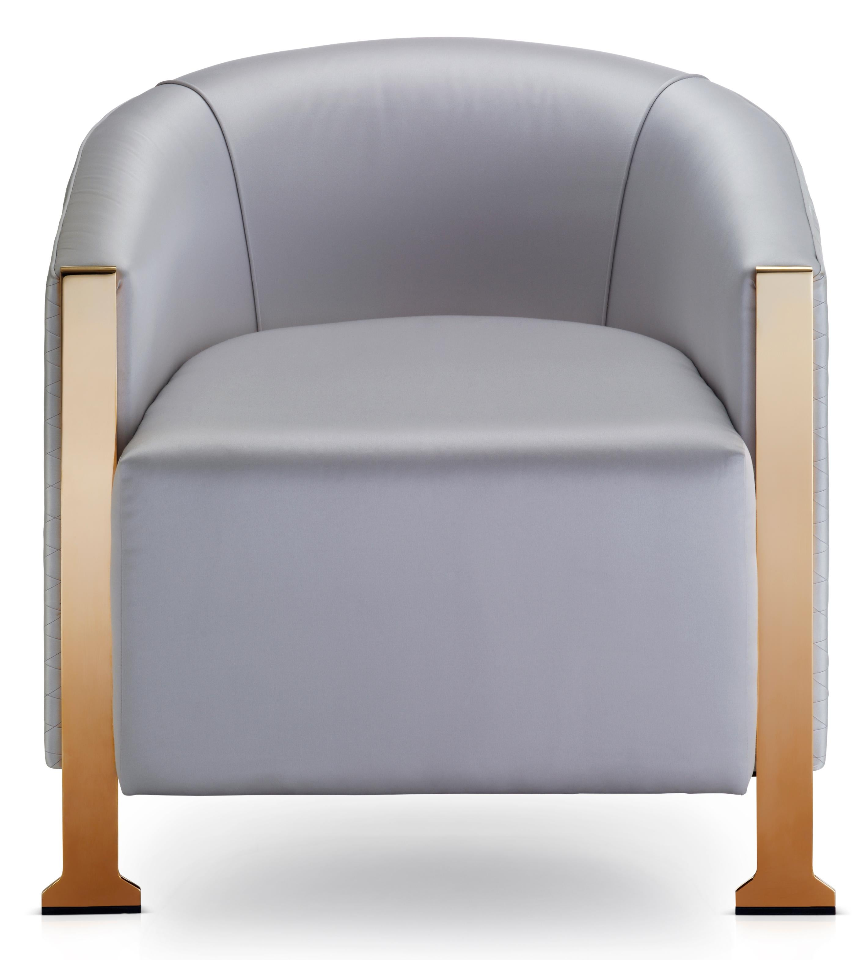 chair stands on bonded leather dusk tub formal modern armchair sculptural metal legs for this beautiful curved polished brass to bring a touch of
