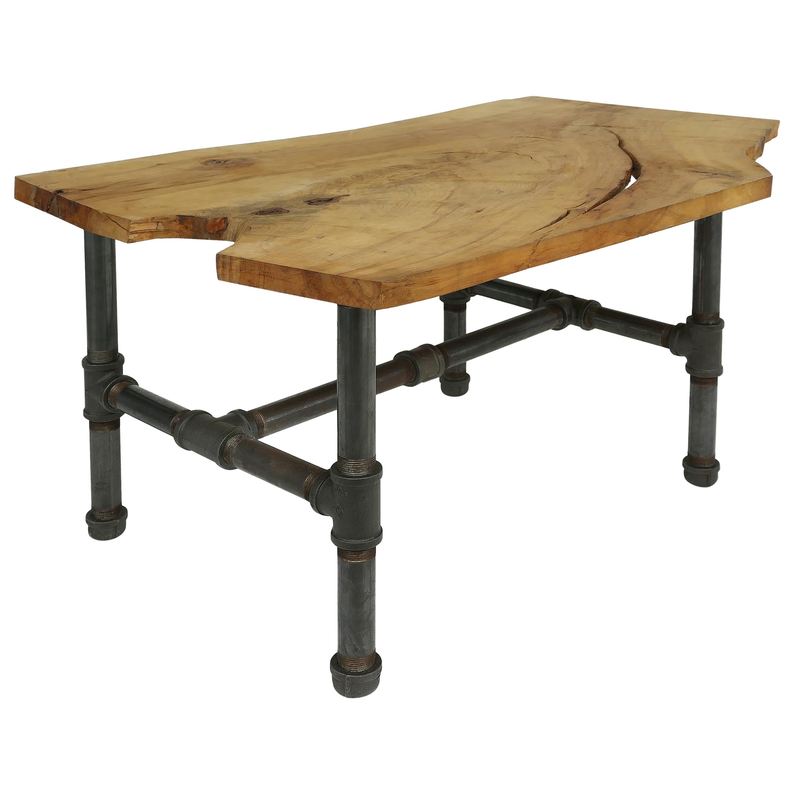 organic wood slab coffee table with industrial iron base