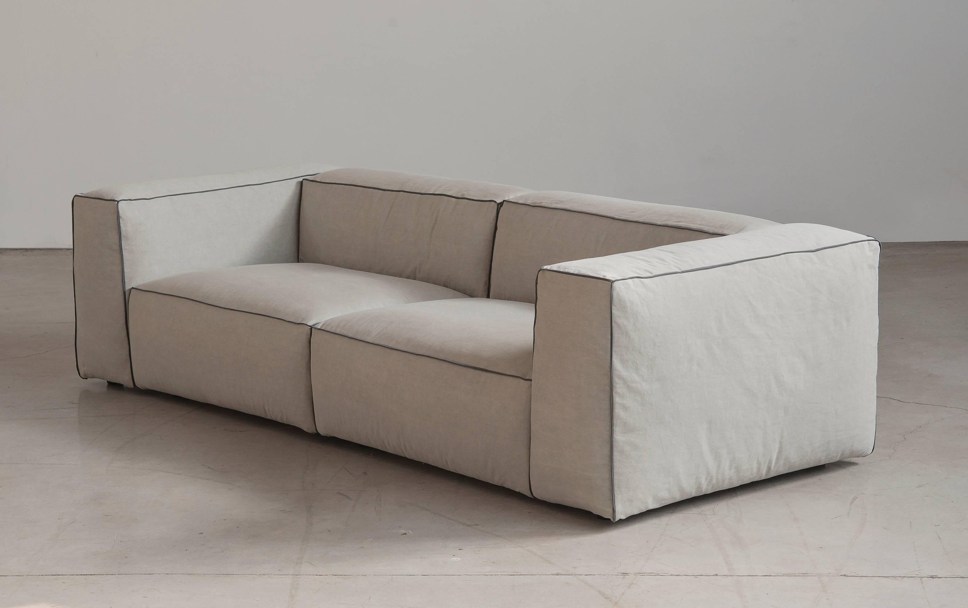sofa 250cm oval oak table sifnos handmade contemporary modular fabric cover fixed seat is an ample inviting couch whose geometric volume and soft finish epitomise the concept