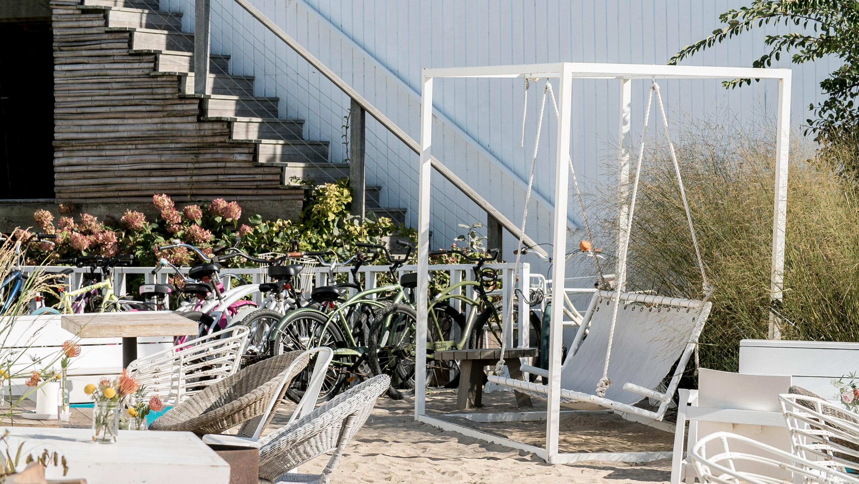swing chair local cast aluminum patio chairs surf lodge custom modern swinging bench crafted in steel this piece was commissioned by the boutique hotel montauk ny