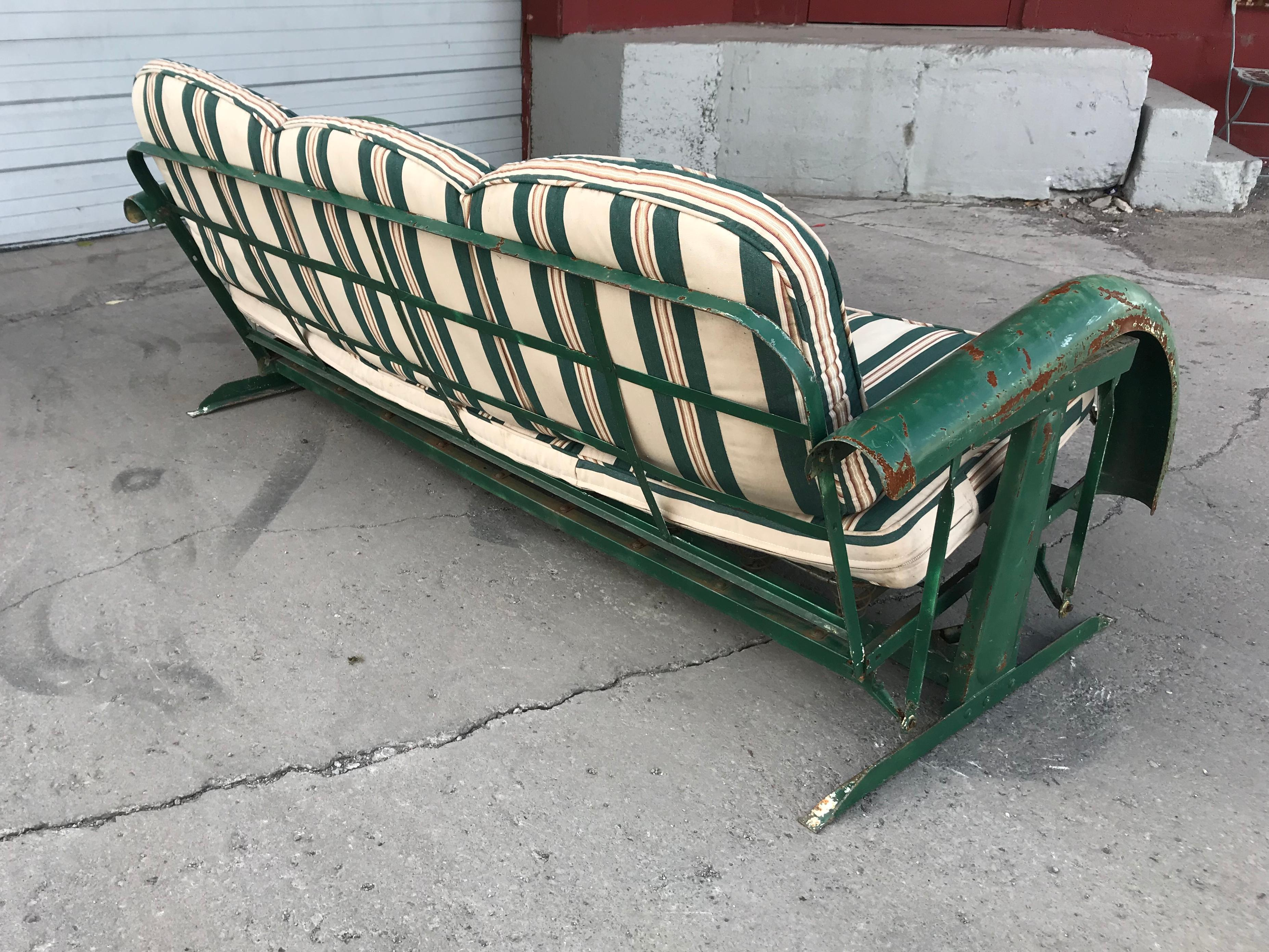 unusual art deco metal porch glider with skirted fenders circa 1930s