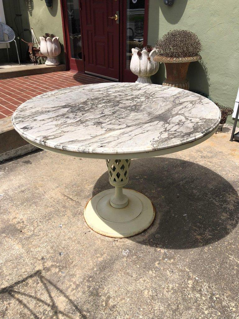 weathered marble top iron patio table