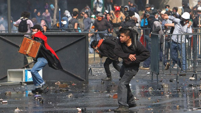 PHOTO: Some protesters clashed with Police on Saturday in Mexico City. It was President Enrique Peña Nieto´s first day in office.