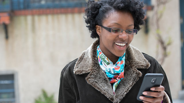 PHOTO:A woman checks messages on her smartphone.