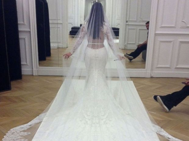 PHOTO: Kim Kardashian had one last fitting of her Givenchy Haute Couture lace gown at the Givenchy atelier in Paris before the wedding ceremony.