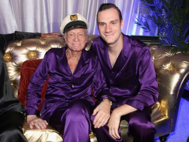 PHOTO: Hugh Hefner and Cooper Hefner attend the Annual Midsummer Nights Dream Party at the Playboy Mansion on Aug. 16, 2014 in Holmby Hills, California.