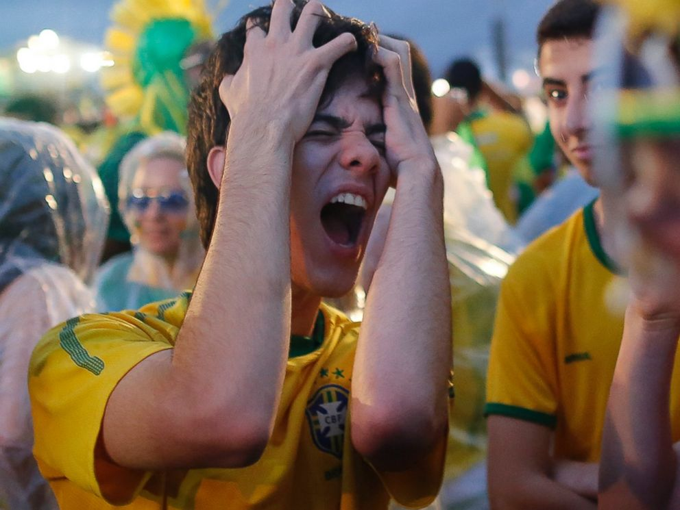 PHOTO: A Brazil soccer fan reacts in frustration as he watches his team play a World Cup semifinal match against Germany on a live telecast inside the FIFA Fan Fest area on Copacabana beach in Rio de Janeiro, Brazil on July 8, 2014.