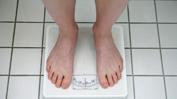 PHOTO: Weigh in once a week for a more accurate number than daily weigh-ins can provide.