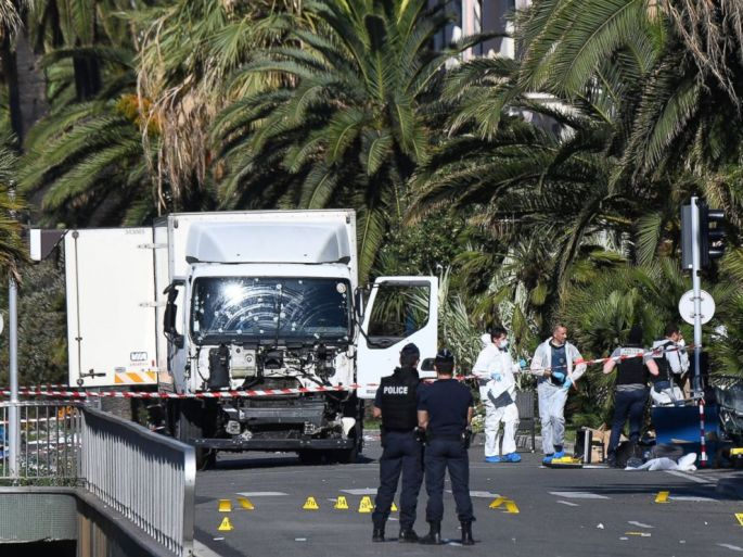 PHOTO: Forensics officers and policemen look for evidences near a truck on the Promenade des Anglais seafront in the French Riviera town of Nice on July 15, 2016, after it drove into a crowd watching a fireworks display.