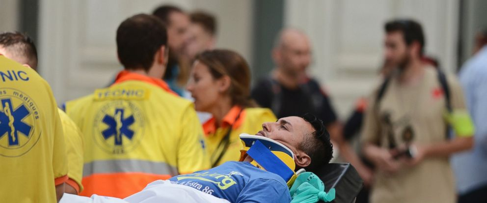 An injured passenger is taken away on a stretcher from a train station in Barcelona, Spain, Friday, July 28, 2017. Catalan government officials say dozens of people were treated for injuries when a morning commuter train they were traveling on crashe