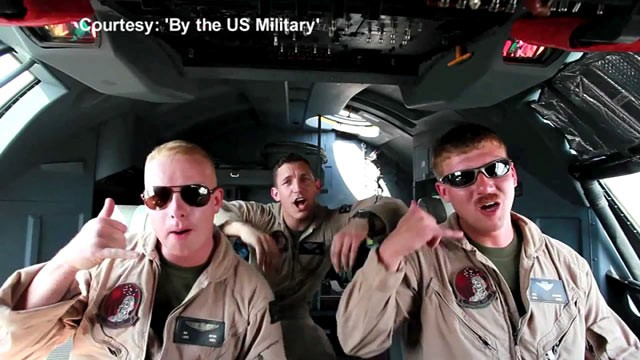 "PHOTO: U.S. Marines stationed in Afghanistan lip-syncing to Carly Rae Jepsen's song ""Call Me Maybe."""