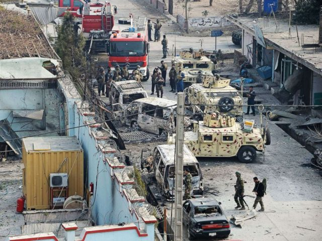 PHOTO: Afghan security personnel gather near an office near the British charity Save the Children after an attack in Jalalabad, Jan. 24, 2018.