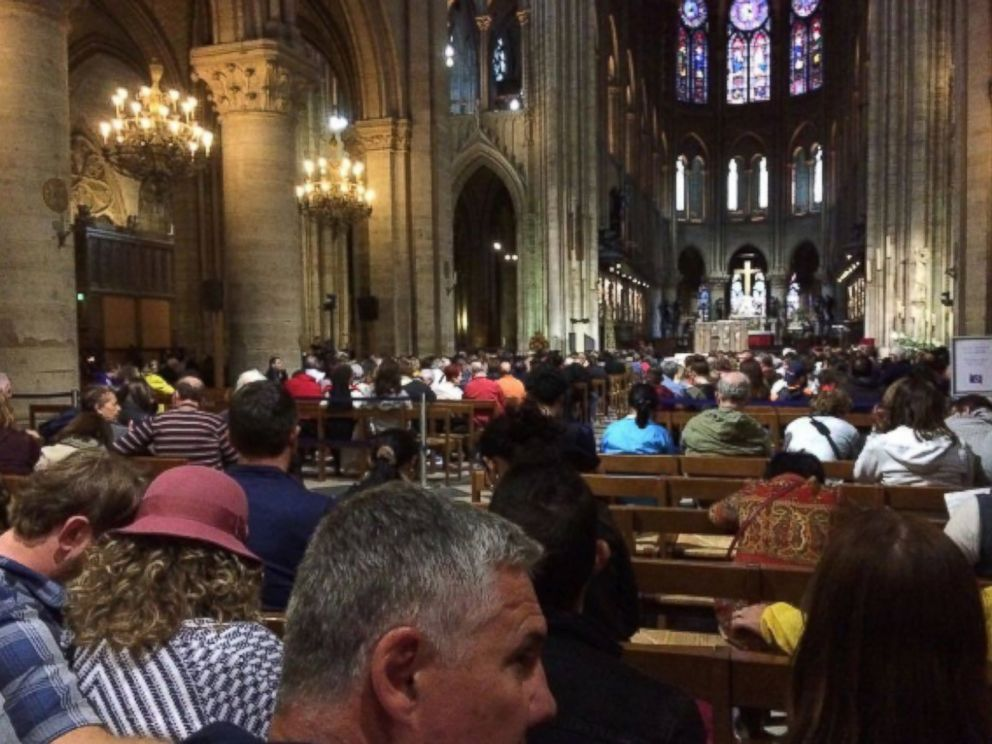 PHOTO: Visitors wait inside of Notre-Dame Cathedral during the incident, June 6, 2017.