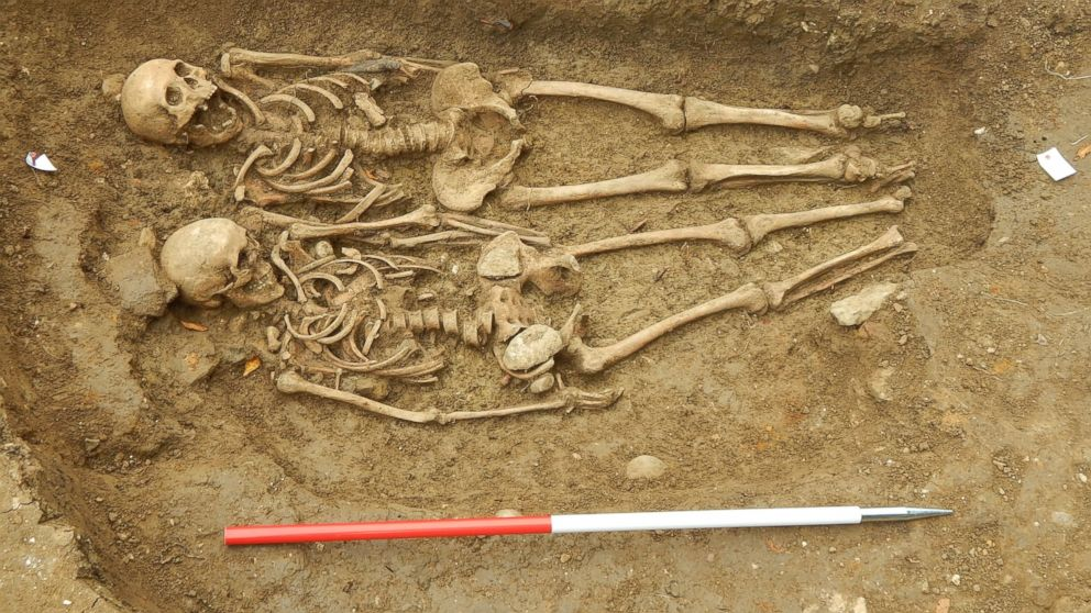 PHOTO: Archaeologists from the University of Leicester Archaeological Services and local volunteers have uncovered the 14th century remains of a man and a woman outside the village of Hallaton in east Leicestershire, England.