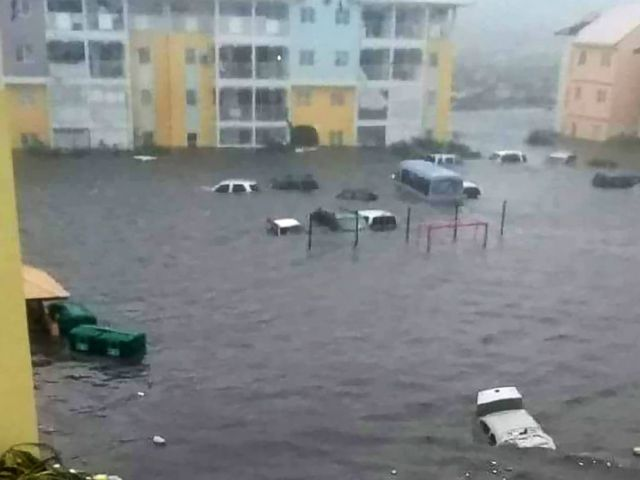 PHOTO: Cars sit on a flooded street on the island of Saint-Martin after Hurricane Irma passed through the Caribbean islands, Sept. 6, 2017.