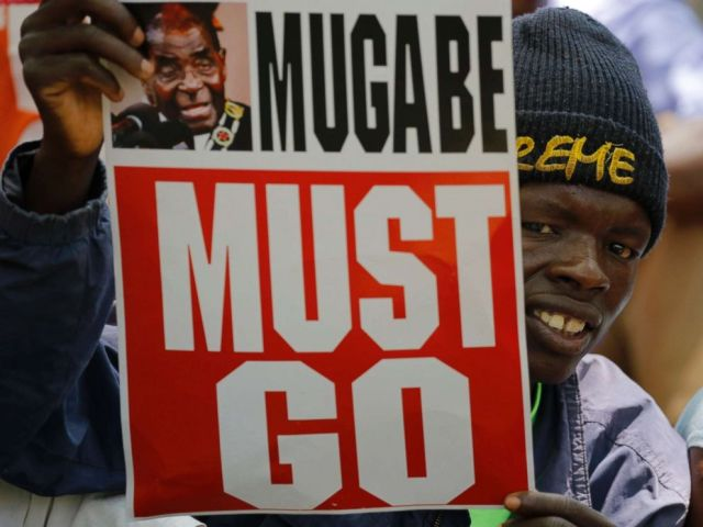 PHOTO: People gather at an opposition party rally outside the state parliament in before the proposed impeachment of president Robert Mugabe, Harare, Zimbabwe, Nov. 21, 2017.