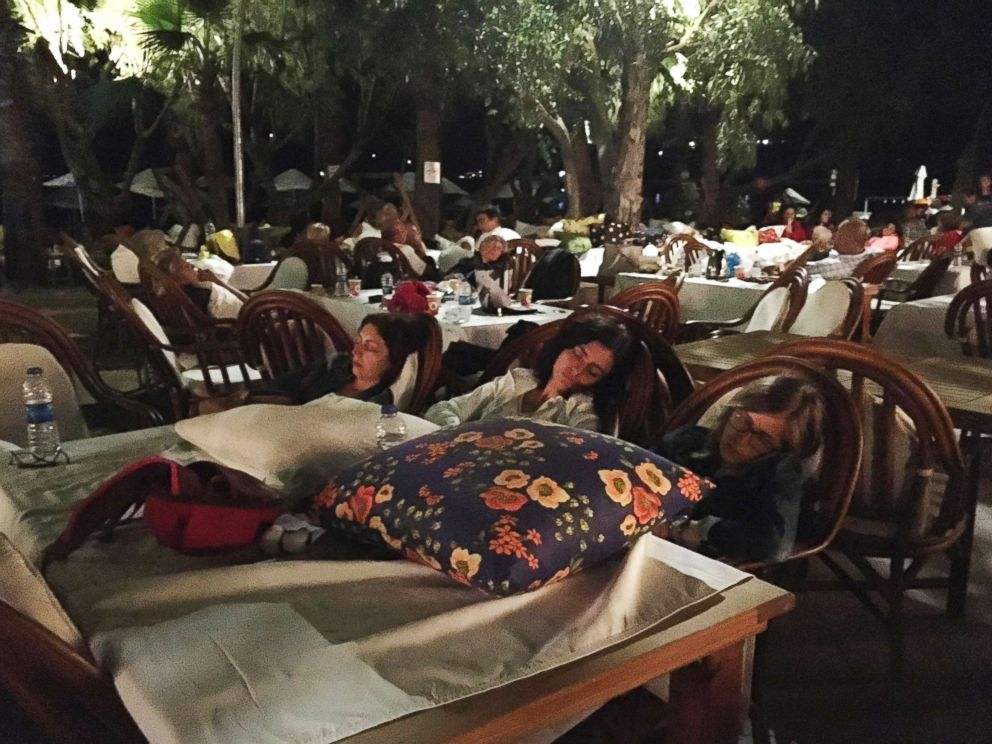PHOTO: Hotel guests sleep outdoors after abandoning their rooms following an earthquake in Bitez, a resort town about 4 miles west of Bodrum, Turkey, early Friday, July 21, 2017.