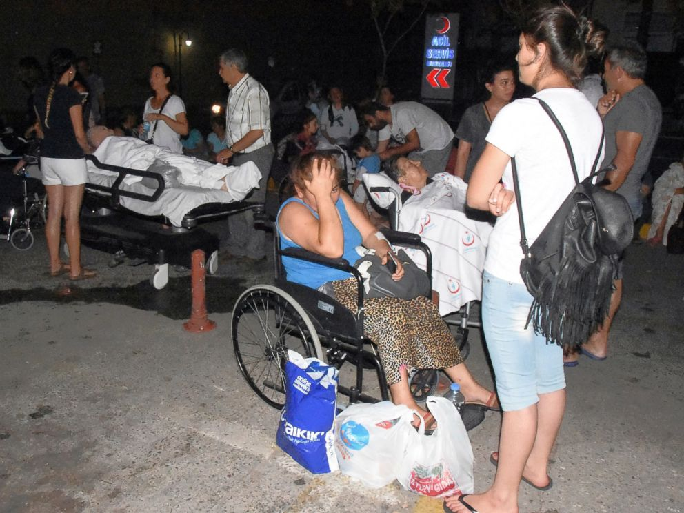 PHOTO: People wait outside the emergency unit of a hospital in Bodrum, Turkey, early Friday, July 21, 2017 after a powerful earthquake struck Turkeys Aegean coast and nearby Greek islands.