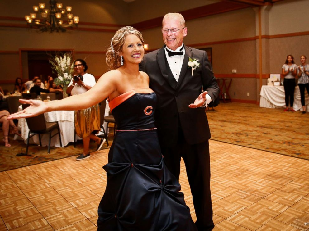 Bride surprises father by wearing Chicago Bearsthemed wedding dress for their dance  ABC News