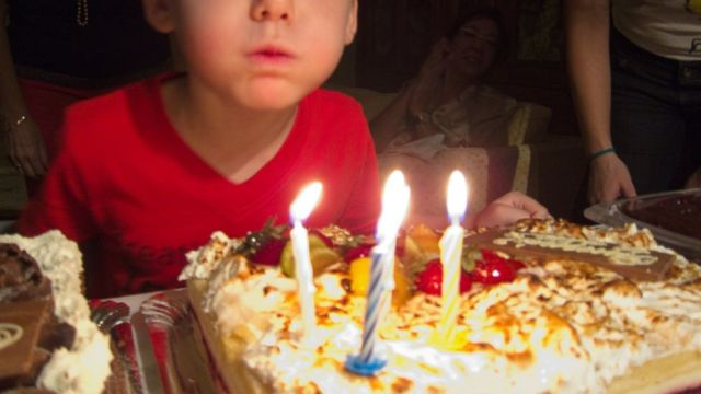 PHOTO: A young boy blows out candles on a birthday cake in an undated stock photo.