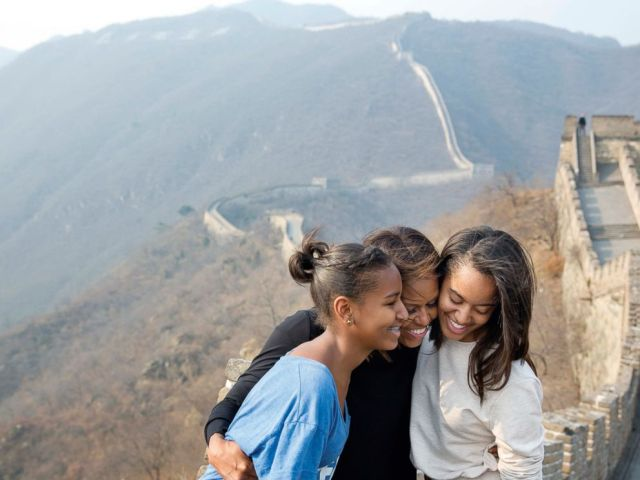 PHOTO: The First Lady hugs her daughters Sasha and Malia as they visit the Great Wall of China in Mutianyu, China, March 23, 2014.
