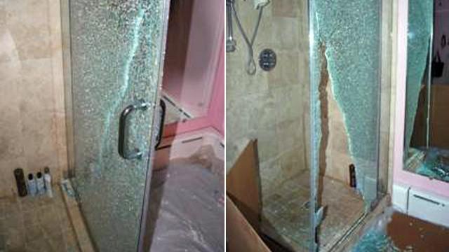 PHOTO: Shattered glass shower door