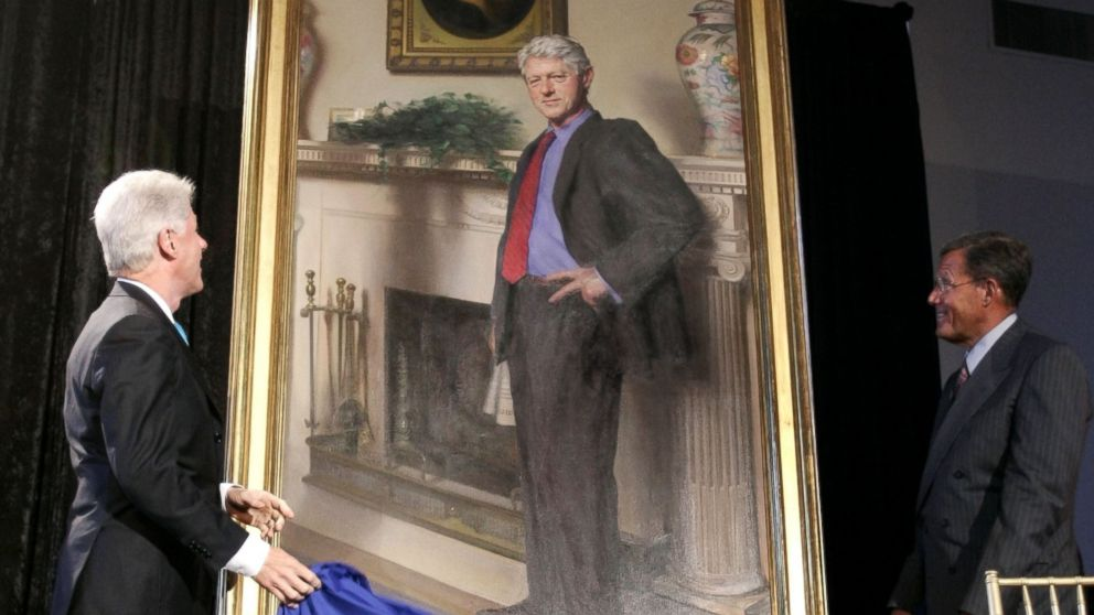 PHOTO: Former President Bill Clinton, left, looks up at his portrait after Lawrence M. Small, secretary of the Smithsonian Institution, right, helped him remove the drape on April 24, 2006 in Washington, D.C.
