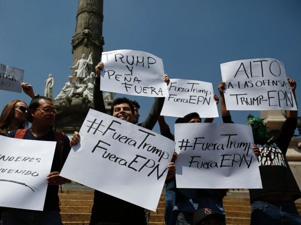 PHOTO: A handful of protestors carry signs with messages that read in Spanish; Trump you arent welcome, and Out Trump, Out EPN, and Stop the offenses of Trump and EPN, referring to Mexicos president Enrique Pena Nieto, Aug. 31, 2016.