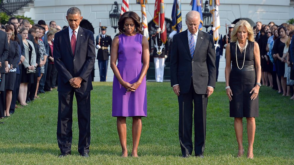 President Barack Obama, First Lady Michelle Obama, Vice President Joe Biden and Jill Biden observe a moment of silence to mark the 12th anniversary of the 9/11 attacks on the South Lawn of the White House in Washington, DC, Sept. 11, 2013.
