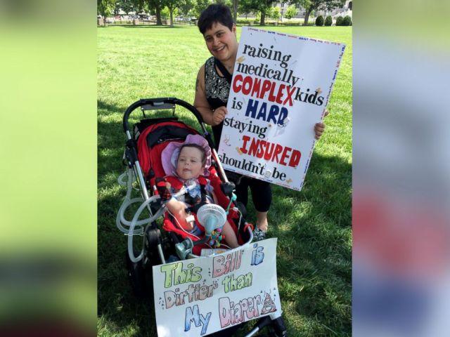 PHOTO: Samantha and Josephine McGovern protest the Senate Republican health care bill on Capitol Hill.